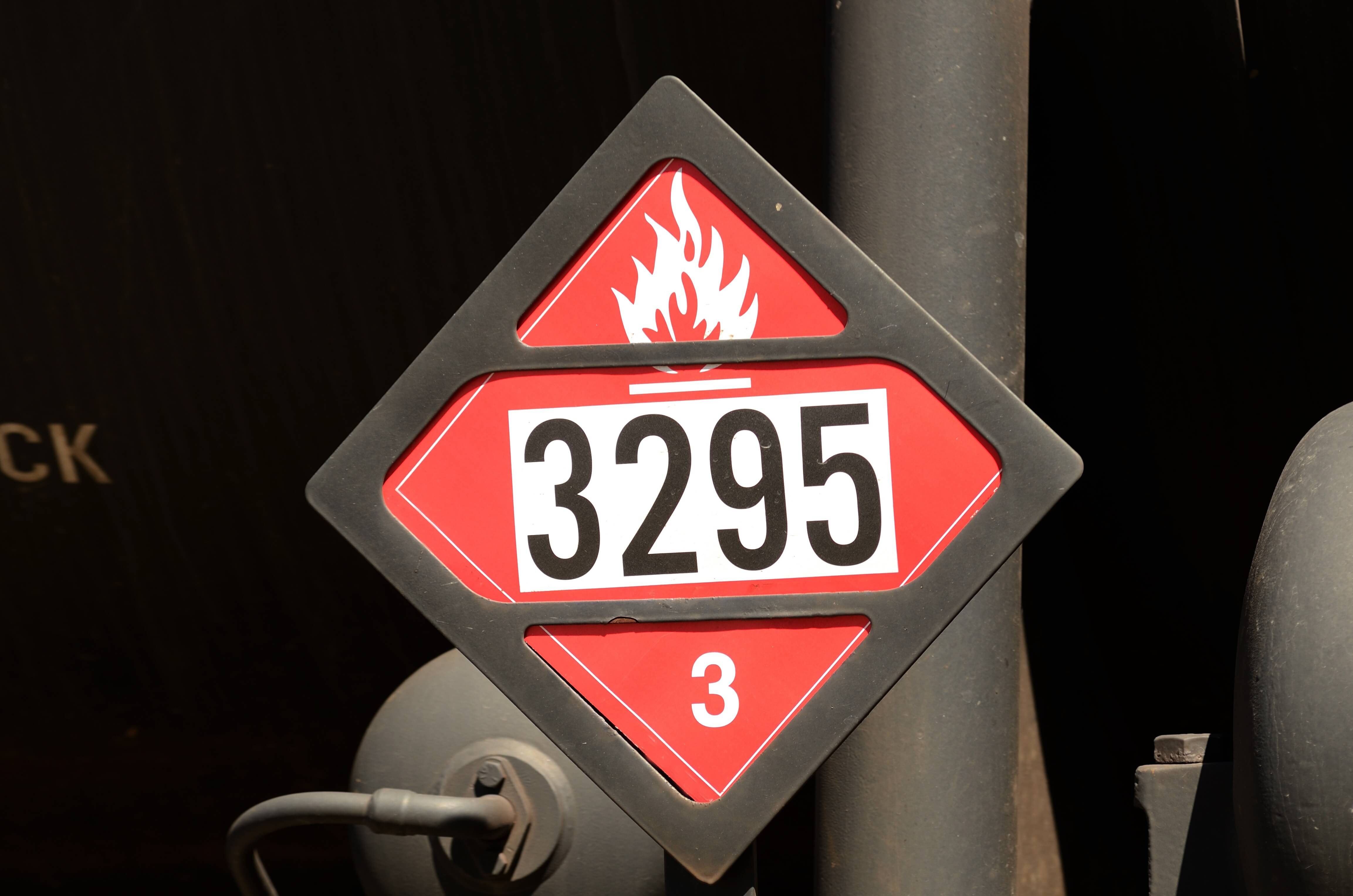 Where should flammable liquids be stored in the workplace